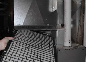 Servicing furnaces with reusable furnace filters