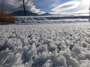 Hoar frost on the surface of Spring Meadow Lake in Helena yesterday.