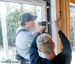 Fastening clips anchor the window to the rough opening in a block-fram window installation.